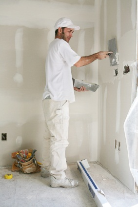 Drywall repair being performed by an experienced Handy Manners drywall technician.
